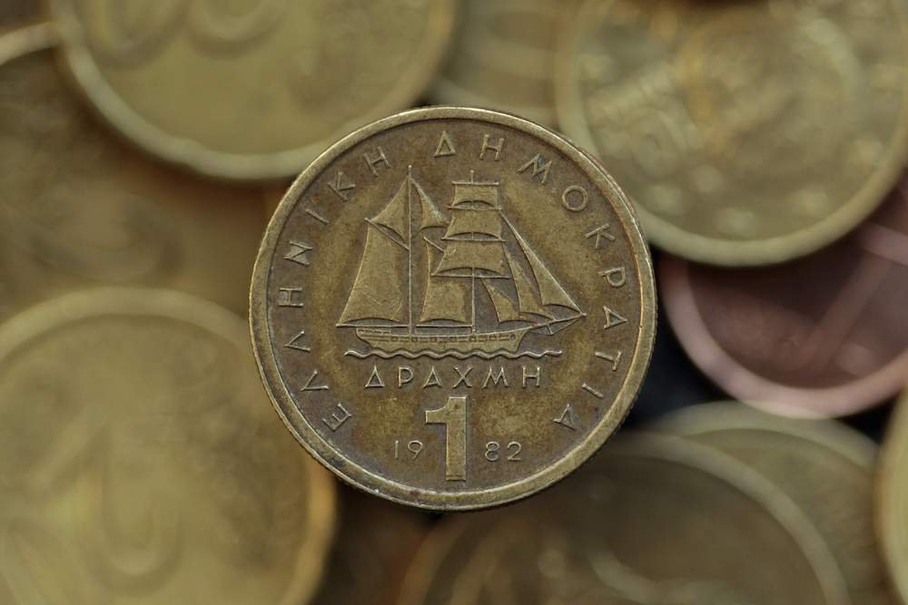 A Drachma Coin Is Seen On Display In This Photo Illustration Taken In Athens May 9, 2012. Banks Are Quietly Readying Themselves To Start Trading A New Greek Currency. Some Banks Never Erased The Drachma From Their Systems After Grece Adopted The Euro More Than A Decade Ago And Would Be Ready At The Flick Of A Switch If Its Debt Problems Forced It To Bring Back National Banknotes And Coins. Picture Taken May 9, 2012. REUTERS/Yorgos Karahalis (GREECE - Tags: POLITICS BUSINESS)